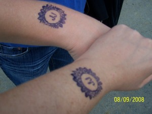 first we got our hands stamped with sticky acrylic paint-type stuff. that's holly's arm on the left, mine on the rigiht. (i know, you all were dying to see what our arms look like.)