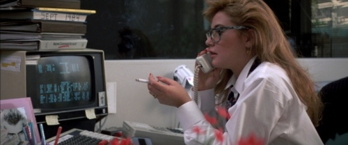 Demi Moore smoking at her desk in the hit 80s movie, St. Elmo's Fire.